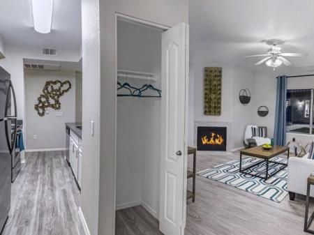 Kitchen, closet and living room at Springs At Continental Ranch Apartments In Tucson, AZ