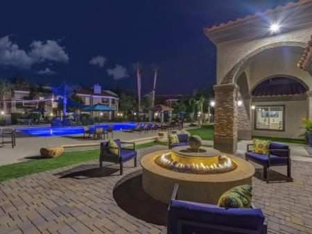 Pool patio and fire pit at Springs At Continental Ranch Apartments In Tucson, AZ