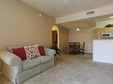 Living room and dining area at Silverbell Springs Luxury Apartments in Tucson, AZ