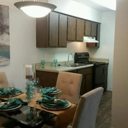Kitchen and dining area at Saguaro Villas Apartments in Tucson, AZ