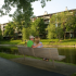 Residents Sitting on Bench Overlooking Lake and Apartment | Lake+House Apartments | Apartments In Wheeling IL