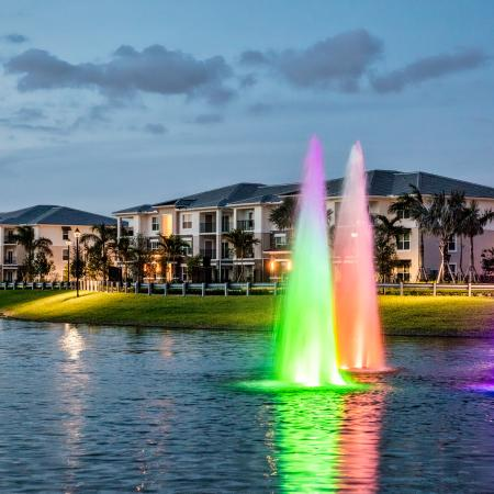 The Reserve at Coral Springs, exterior, dusk, buildings, rainbow fountains in pond
