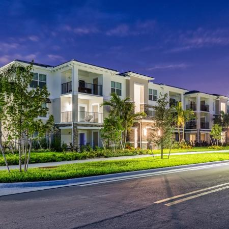 The Reserve at Coral Springs, exterior, night, brightly lit apartments with balconies