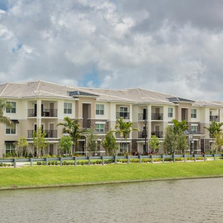 The Reserve at Coral Springs, exterior, buildings, water view, palm trees, balconies