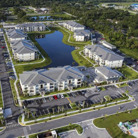 The Reserve at Vero Beach, exterior, aerial view of property, buildings, clubhouse, pond