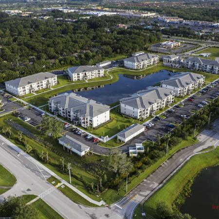 The Reserve at Vero Beach, exterior, aerial view of the property, 7 buildings, pond in the center, landscaped