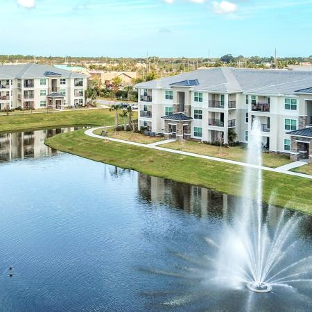The Reserve at Vero Beach, exterior, aerial view of pond, fountain, 2 buildings