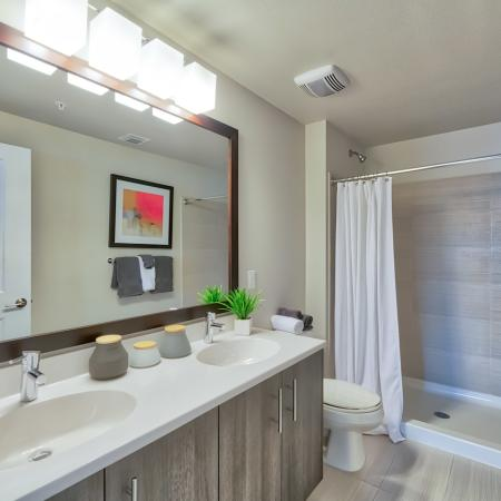 The Reserve at Vero Beach, spacious bathroom, double sink vanity, large mirror, shower, toilet