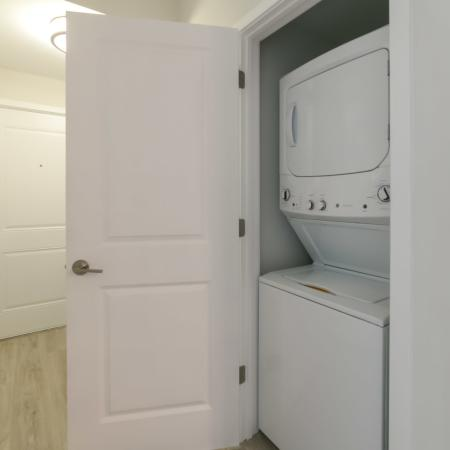 The Reserve at Vero Beach, interior, hallway laundry closet, white stack-able washer and dryer