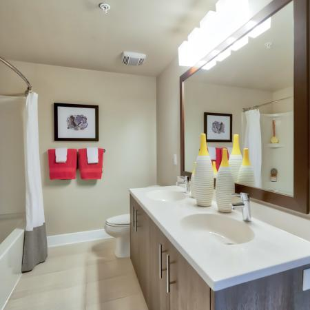 The Reserve at Vero Beach, interior, spacious bathroom, double sink vanity, large mirror, toilet, tub, shower, bright lighting