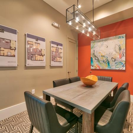 The Reserve at Vero Beach, interior, conference room, orange accent wall, dining table, chairs