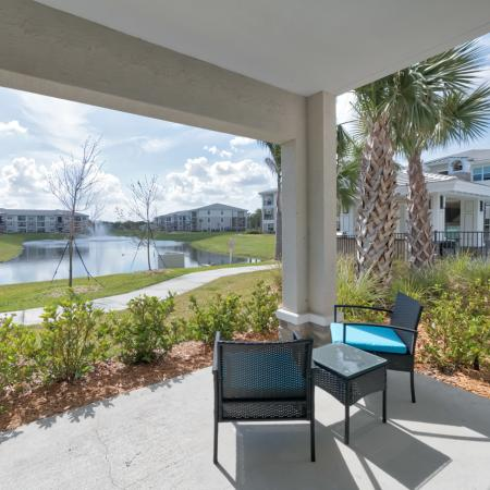The Reserve at Vero Beach, exterior, covered patio, view of the pond, view of other apartment exteriors