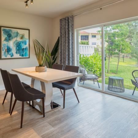 The Reserve at Coral Springs, interior, dining room, large sliding glass doors to patio, landscaped view