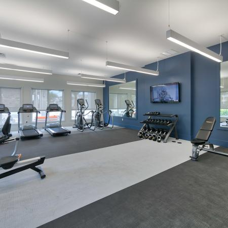 The Reserve at Coral Springs, interior, fitness center, rowing machine, treadmills, hand weights, elliptical