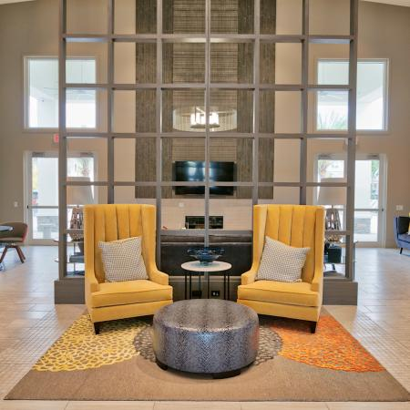 The Reserve at Coral Springs, interior, clubhouse, seating area, yellow arm chairs