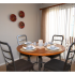 Glen Arms Apartments, interior, dining room, sliding glass doors, blinds, round wood table, 4 gray chairs, set for four