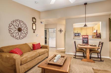 Large living room with couch, loveseat, table and entertainment center