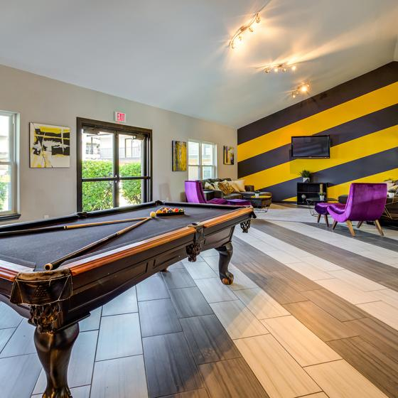 Game room will billiards table and seating