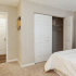 Furnished bedroom with large closet