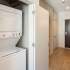 In-unit stacked washer and dryer