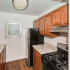 Kitchen with stainless steel appliances and wood cabinets