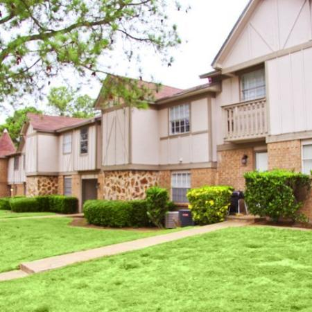 exterior of 2 story apartment buildings | Royal Crest rentals