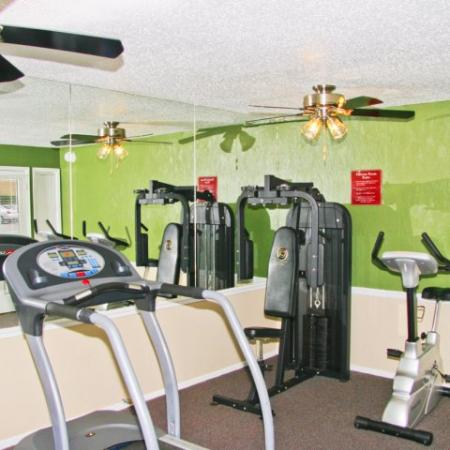 Royal Crest fitness center with cardio and weight equipment