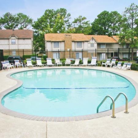 Royal Crest apartment community pool with lounge chairs