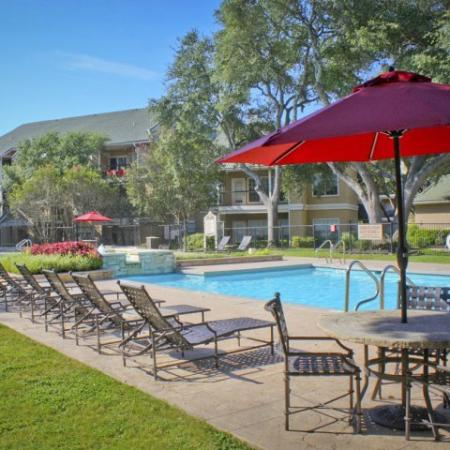 Sedona Springs community pool with lounge chairs, tables and umbrellas