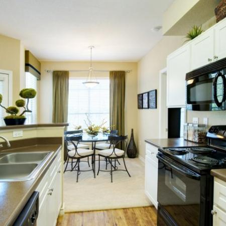 Kitchen with electric appliances | Museo apartments