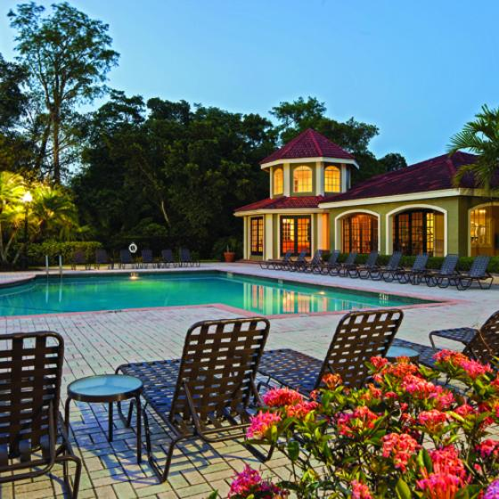 Cypress Shores, exterior, night, pool deck, lounge chairs, clubhouse