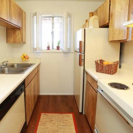 Kitchen with electric appliances, wood cabinets and wood flooring | Valley View