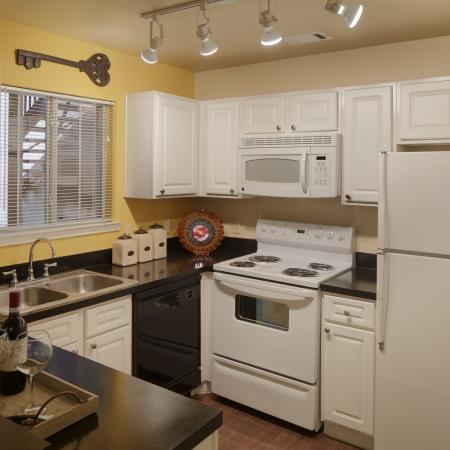 Apartment kitchen with built-in microwave | Austin TX