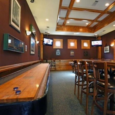 Game room with shuffleboard table | Lodge at Lakeline