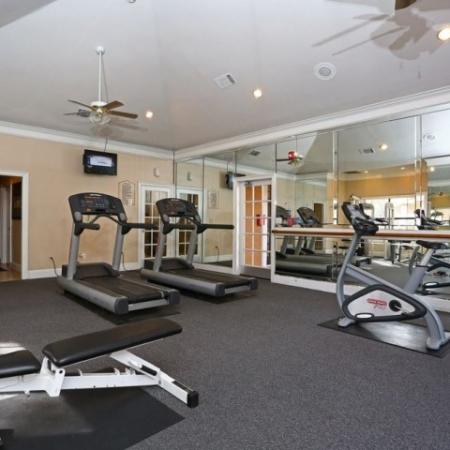Fully-equipped gym in apartment complex | Madison at Stone Creek