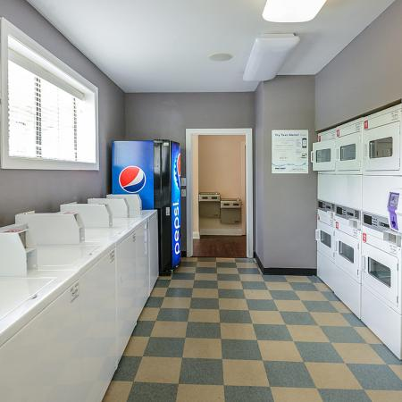Clothing care center with washers and dryers | River Birch apartments