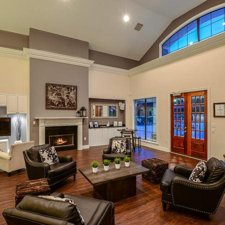 Lounge area with fireplace in River Birch clubhouse | Apartment community in Charlotte
