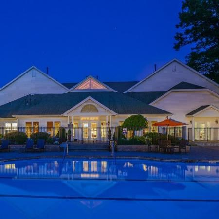 Nighttime view of the pool and clubhouse