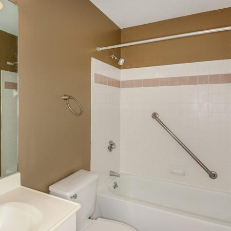 Apartment bathroom with shower bathtub combo