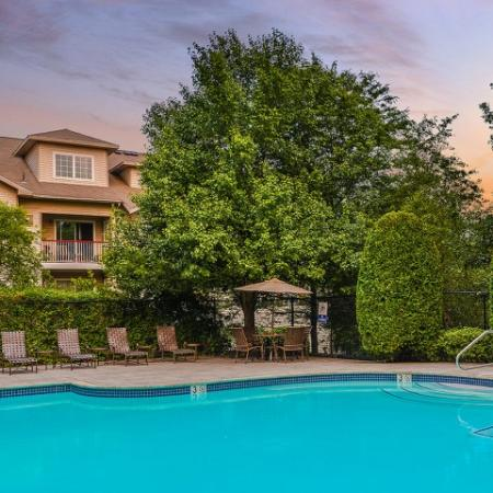 twilight at Residences at Westborough pool with poolside lounge chairs