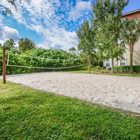 Sand volleyball court | Yacht Club at Heritage Harbor | community amenity