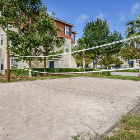 Apartment complex sand volleyball court | Yacht Club at Heritage Harbor