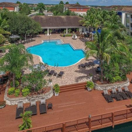 Community pool and sundeck with seating | Yacht Club | Bradenton FL apartments