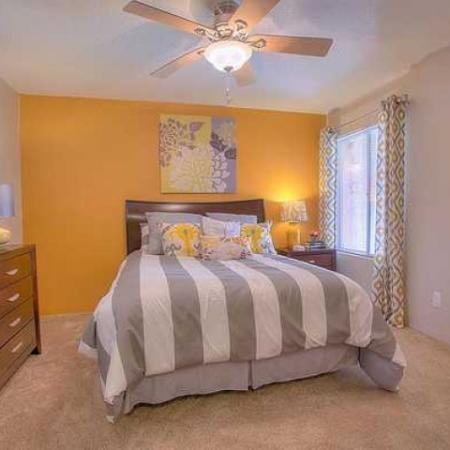 Master bedroom with carpeted floors and ceiling fan | Vizcaya apartments