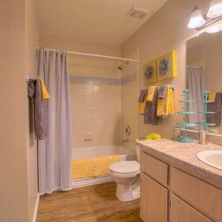 Master bathroom with shower bathtub combo and wood floors