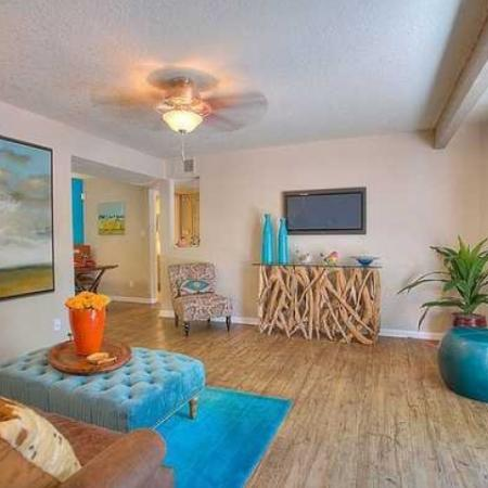 Living room with hardwood floors and ceiling fan | Vizcaya 2 bedroom apartment