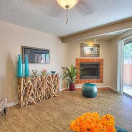 2 bedroom apartment living room with fire place and door to patio | Vizcaya rentals