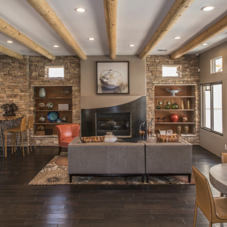 Vizcaya clubhouse and leasing center interior with seating areas and fireplace