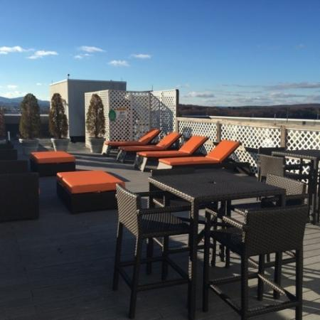 Roof top deck with lounges and tables at The Residences at Manchester Place