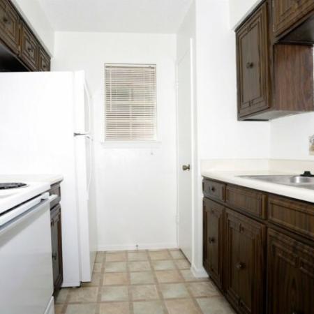Royal Crest apartment kitchen with electric appliances
